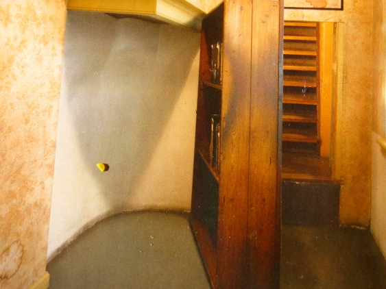 The original bookcase and secret stairway to the Annex