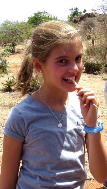 Schuyler using the traditional Maasai toothbrush (a twig)