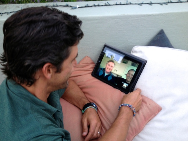 Jeff skypes with his parents on our roof deck