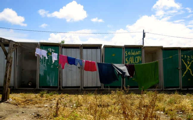 Laundry hanging near the outhouses - there is no running water