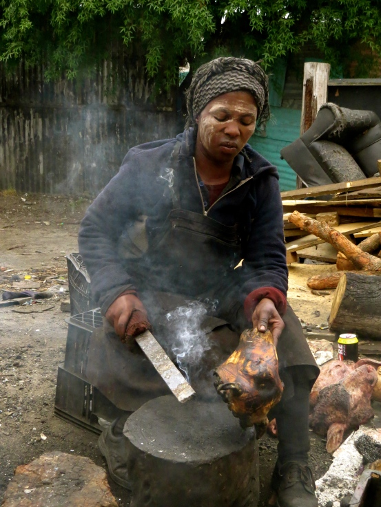 Woman cooking the sheep head