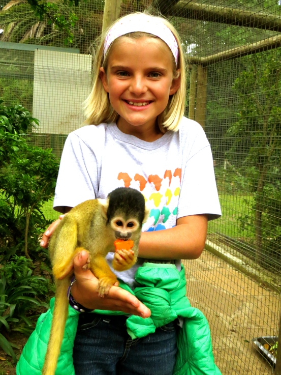 Holding a monkey is a dream come true for Zoe