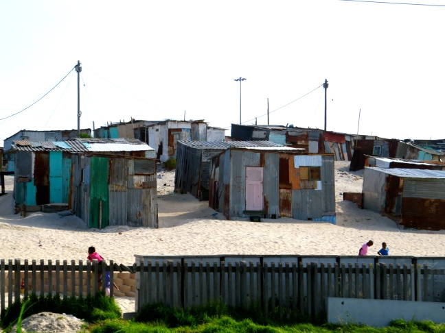 A township perched precariously along sand dunes