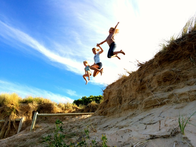 A daily event, cliff jumping from the sand dunes