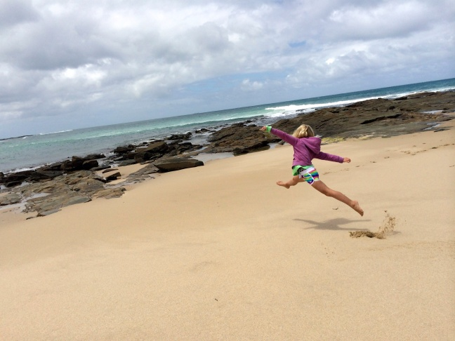 Thayer leaps her way across the deserted beach