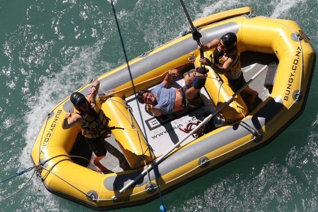 After the jump, the boat picks Jeff up to deliver him ashore