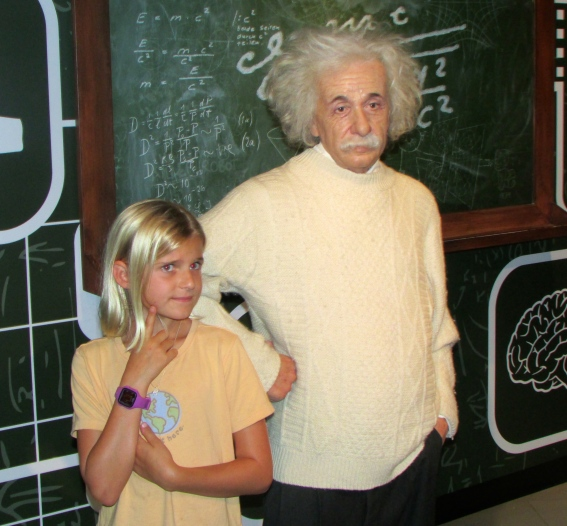Zoe cozies up to Einstein at Mme Tussauds