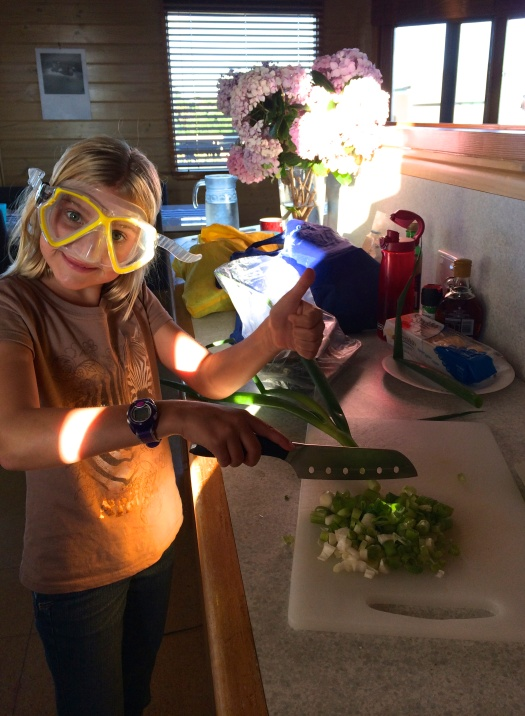 Zoe improvises tear prevention while chopping onions