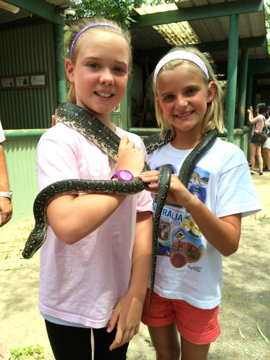 Bravest of them all, Zoe and Taylor share a snake at Featherdale Wildlife Center