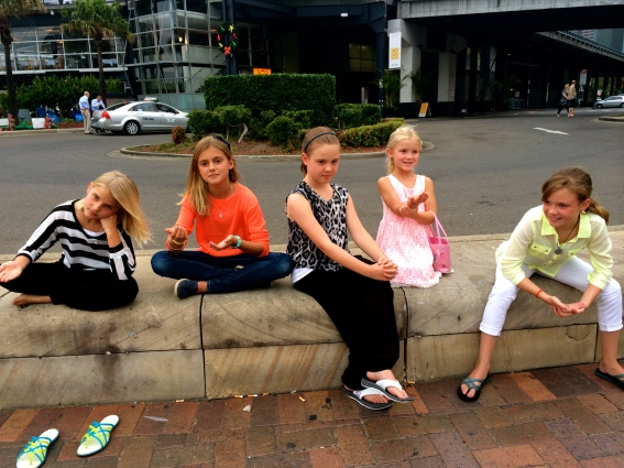 The girls imitating street performers, frozen in poses, hoping for tips