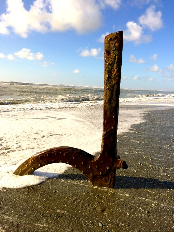 A piece of scrap from an old ship adorns the beach