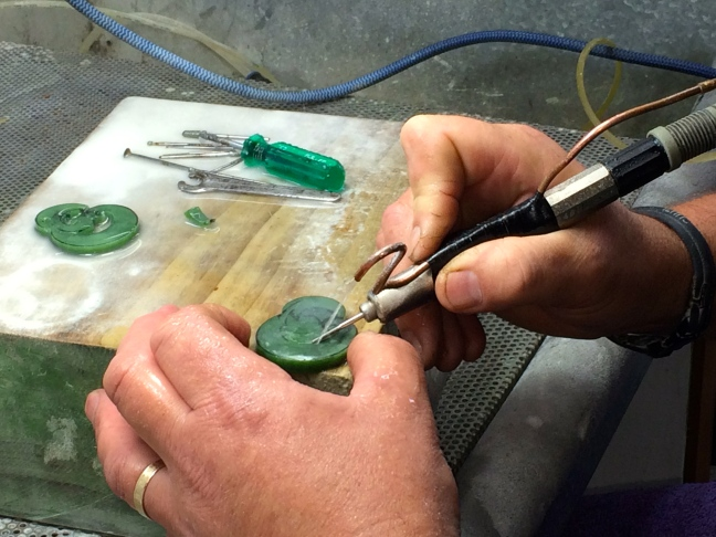 Carving a jade medallion