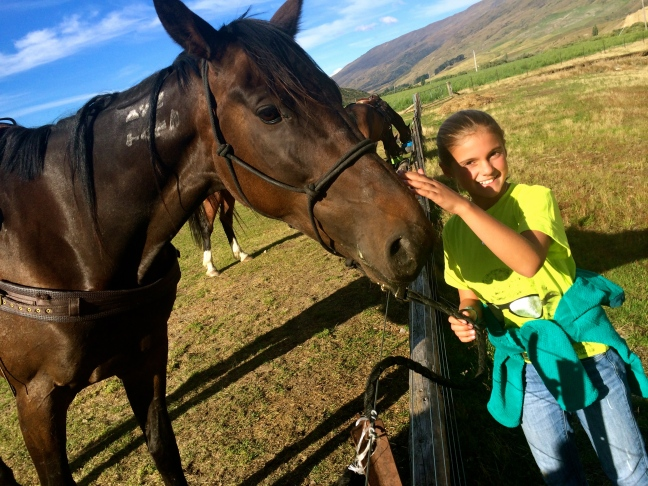 Schuyler thanks her horse, Boss, for a great ride