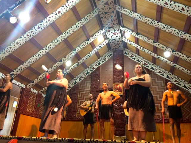 Maori cultural performance, note the warrior face in the middle