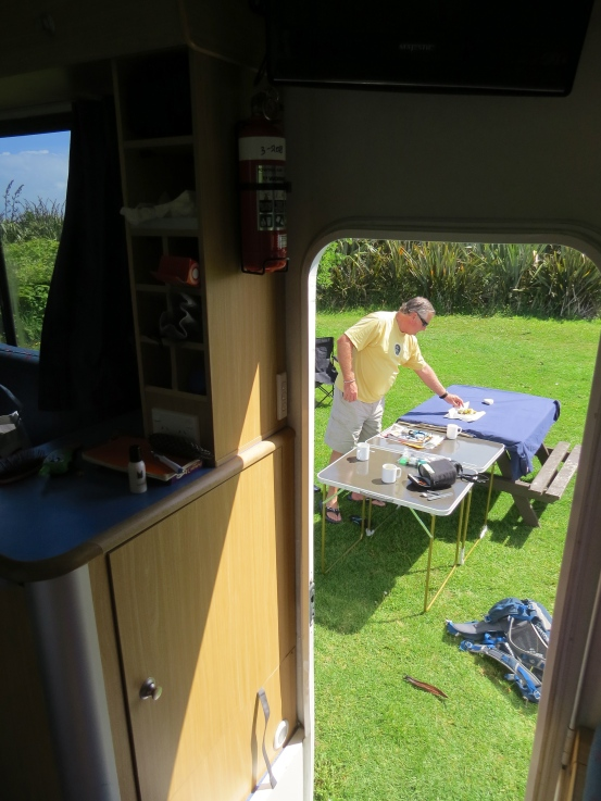 A view from inside out - Pepe setting up the tables at our campsite