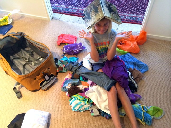 Zoe, with the contents of her suitcase after 5 months on the go