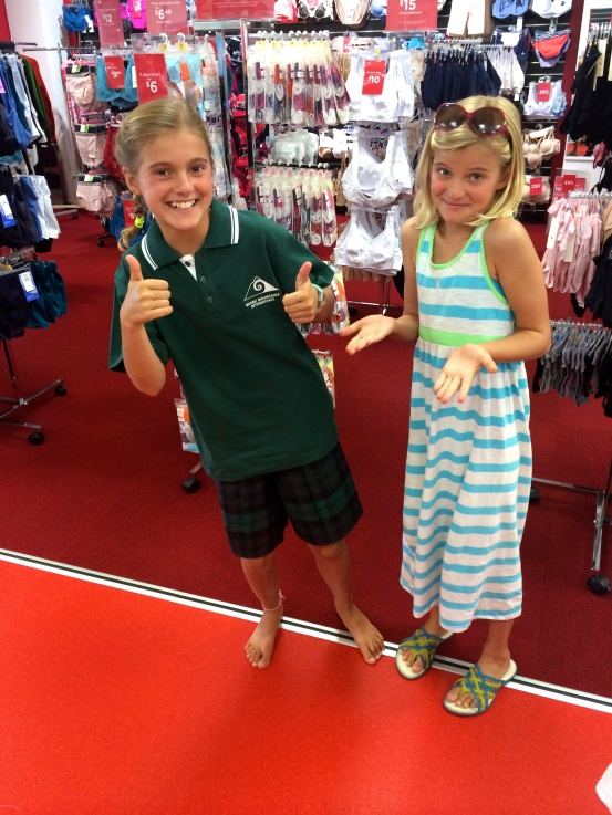 Schuyler tries on her school uniform at a clothing store in town