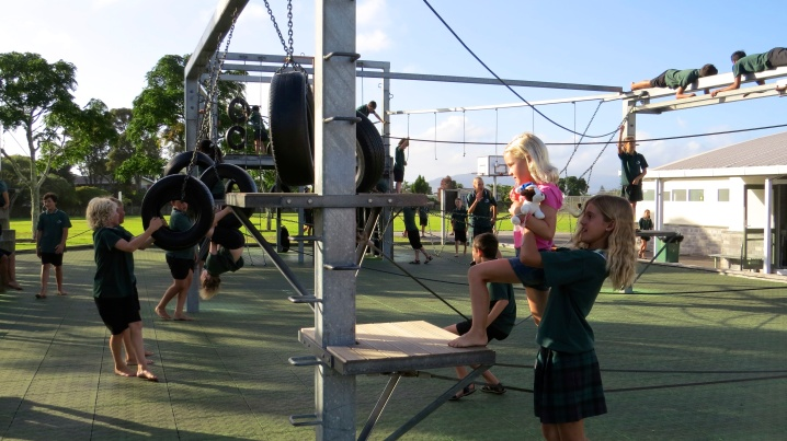 Showing Thayer the ropes, literally, on our school playground