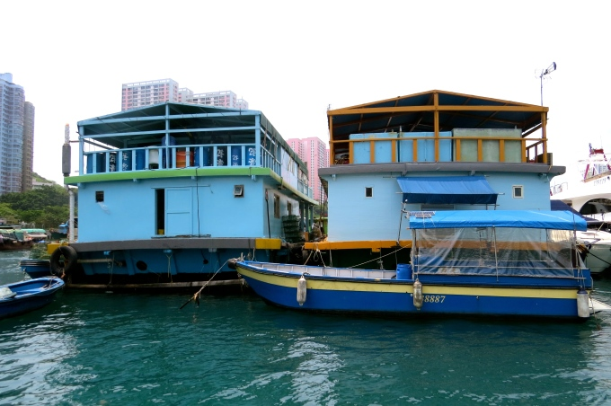 Wealthier fishermen now live in these larger houseboats, each of which will house 3-4 generations of one family