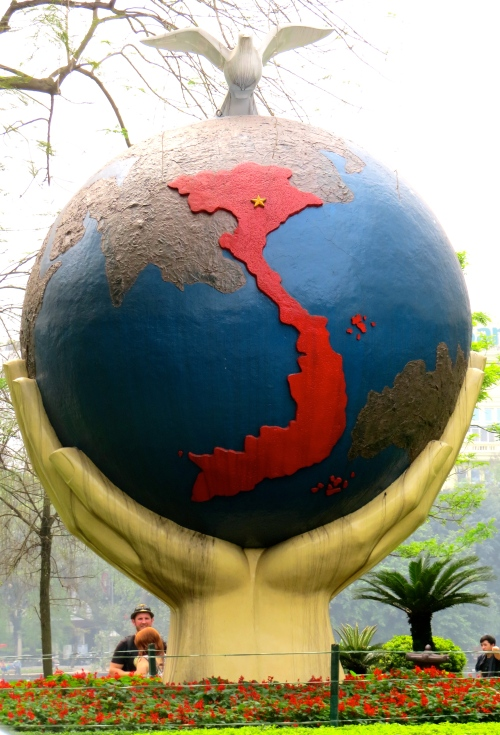 Hanoi statue holding the world, highlighting Vietnam and capital city (Hanoi) at the top