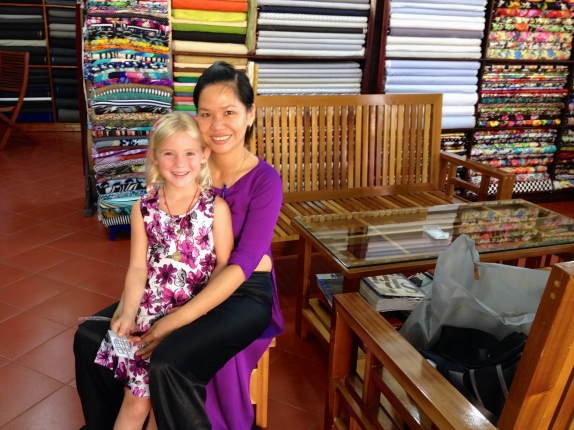 Thayer and her helper, Vinh, wearing one of her new designs!