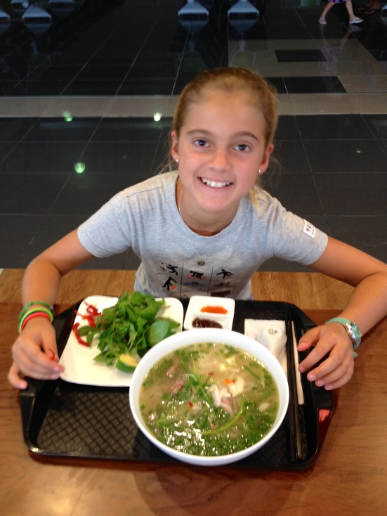 Schuyler enjoys a final bowl of Pho, traditional noodle soup, at the Hanoi airport