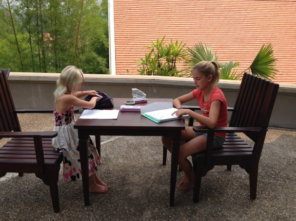 Schuyler and Thayer doing school work at our hotel