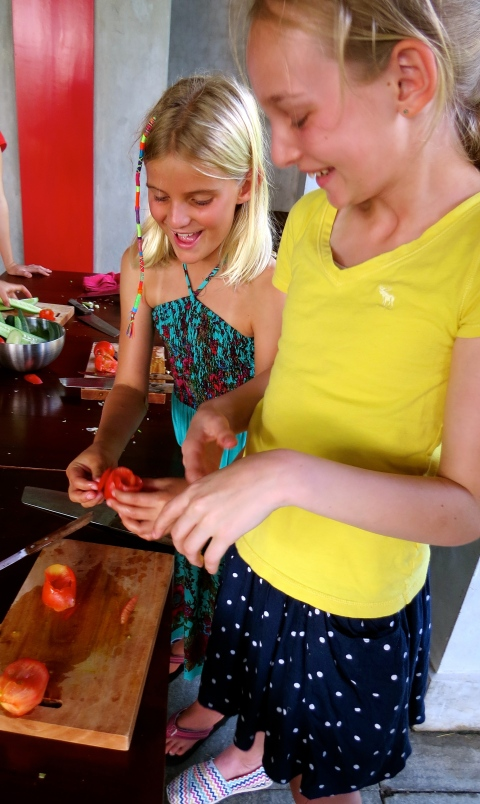 At the end of our class, we tried our hands at food carving, making roses out of tomato peels.  Easier said than done!