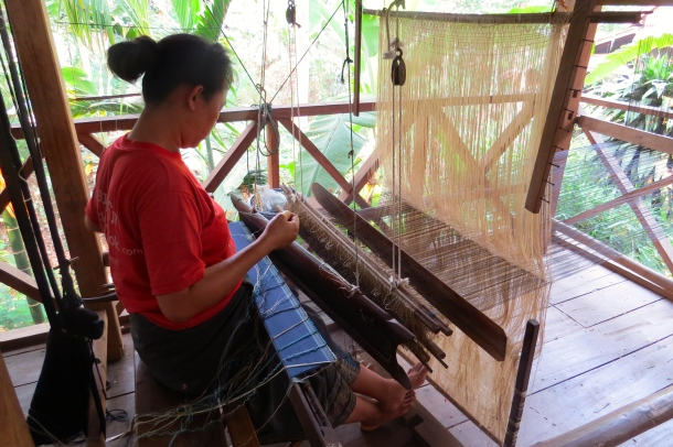 One of the many weavers at the Center