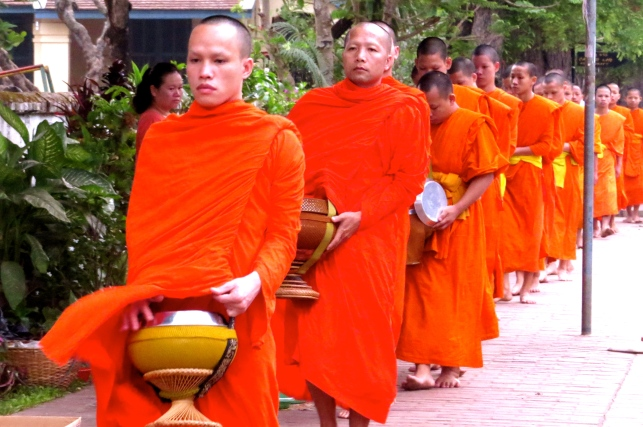 Monks processing along the street, collecting alms