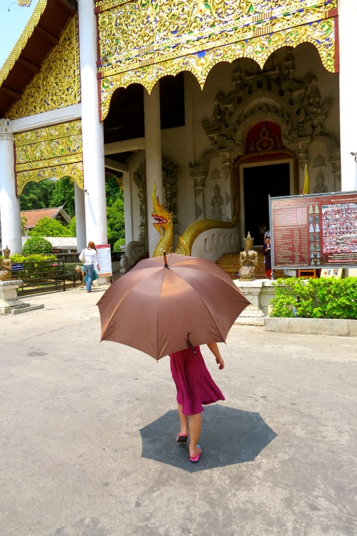 Thayer under cover, heading toward the Wat's entrance