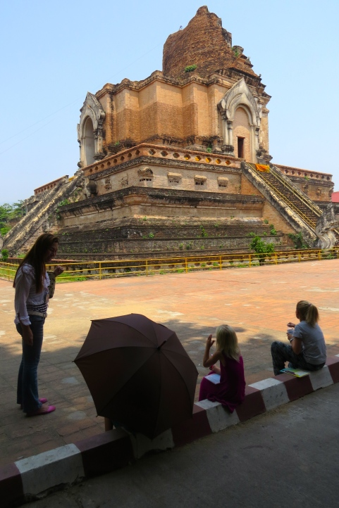 In the shade near the stupa, the girls learn from our guide about the earthquake in 1545 that toppled much of the original strucure