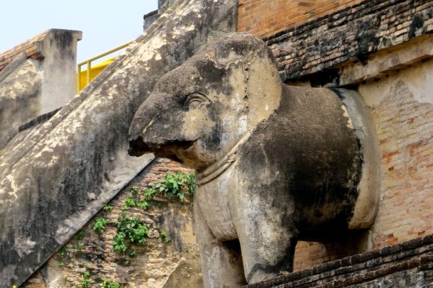 Last original remains of the Lanna style elephant sculptures jutting out from the stupa's walls