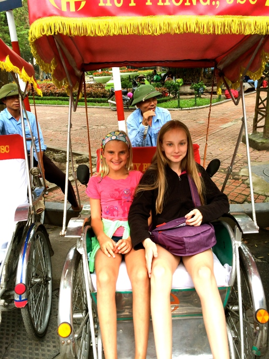 Haven and Zoe cozy up in their rickshaw