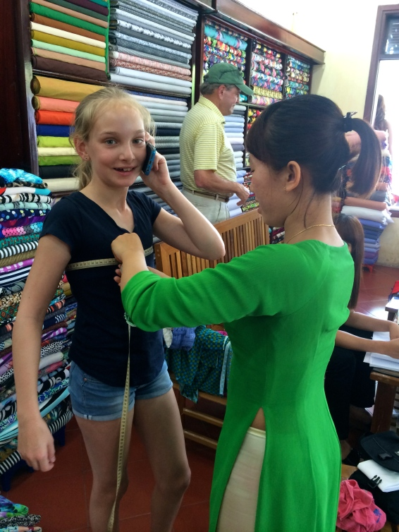 Like a superstar, Haven had to multitask - wishing her father a happy birthday back in Seattle, while getting measured for her new clothes!