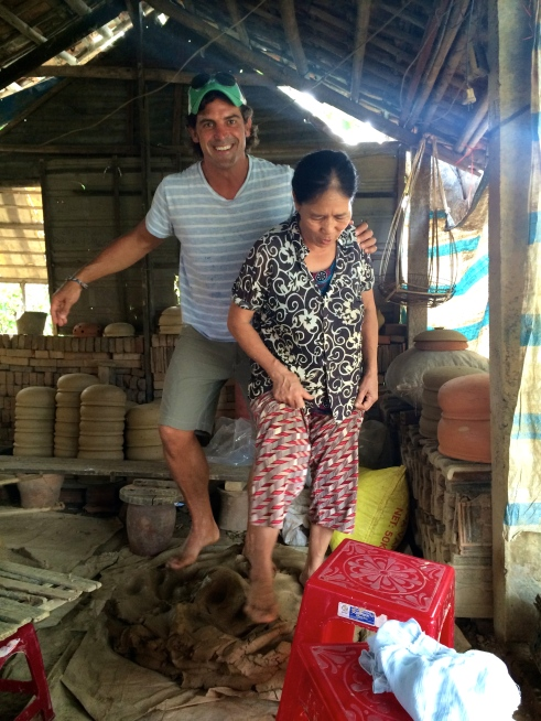 When Jeff saw this woman kneading the clay with her feet, he couldn't help himself