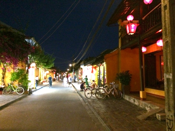 Hoi An at night, lit by lanterns lining the streets