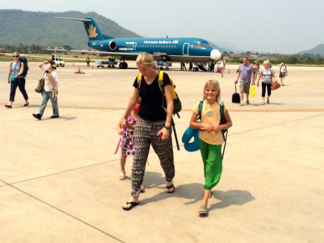 On the tarmac in Laos - blasted by the 100 degree heat!