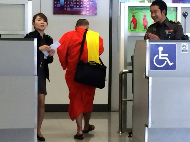 A monk on our flight, heading through passport control in Chang Mai just before us