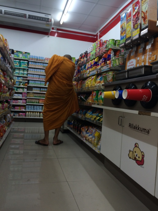 Jeff snapped this photo of a monk in the aisle of a 7-11 across the street from his temple.  East meets West!