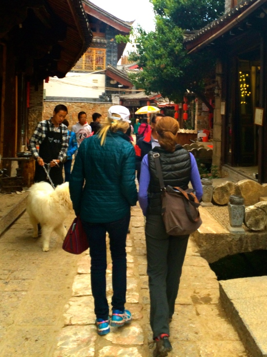 College pals, strolling Lijiang's narrow streets