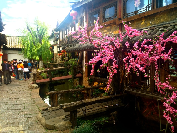 Narrow cobbled street in Lijiang's Old Town, with canals running throughout.