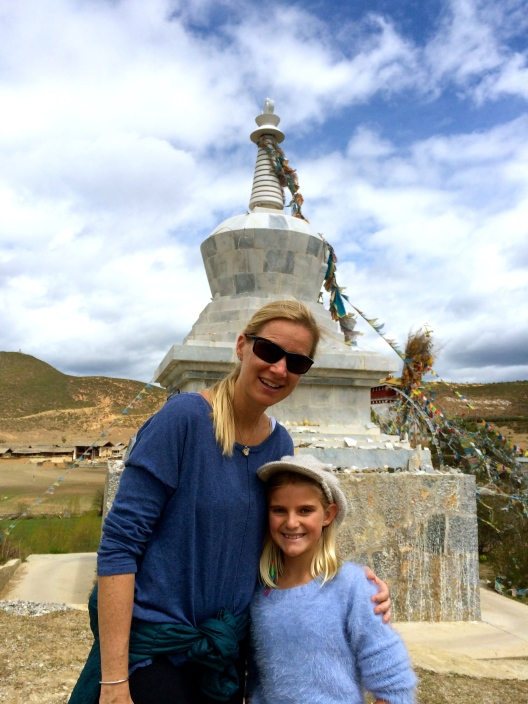 Zoe and Blair explore a stupa along the way