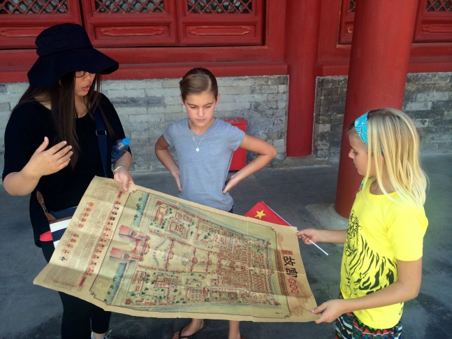 The girls take a look at a big diagram of the Forbidden City, deciding where to begin our exploration