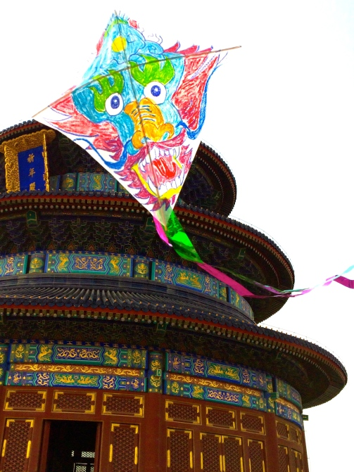 Jeff's dragon kite soars in front of Lanna Temple
