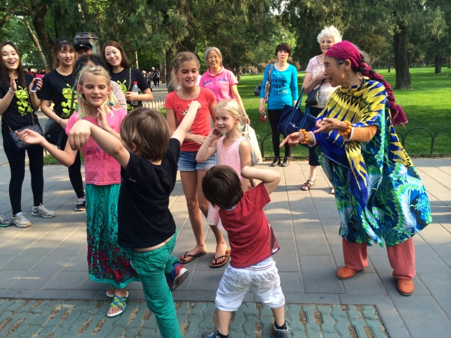 The kids enjoy a dance party in the park, with some local entertainers
