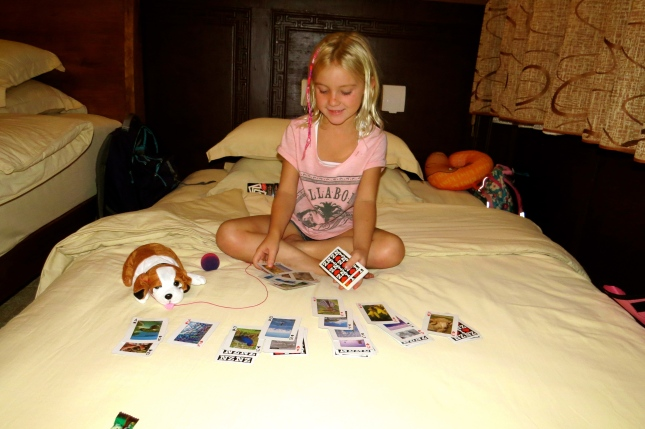 Thayer relaxes with a game of Solitaire on her bed