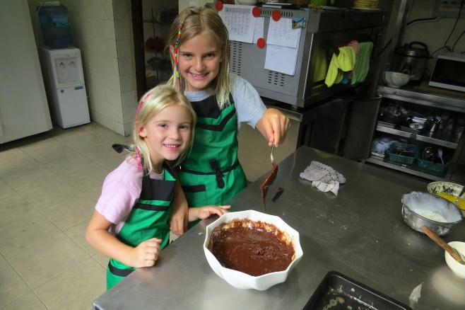 Zoe and Thayer mixing the chocolate
