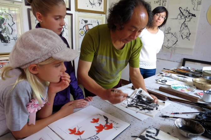 Mr. Wu demonstrated how to use the brushes and ink