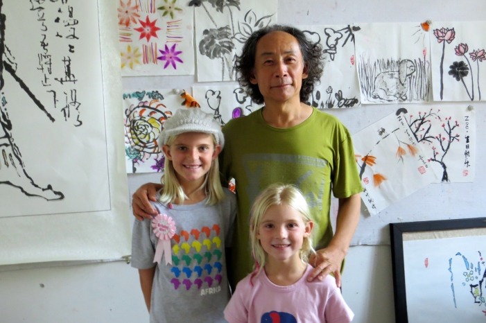 Mr. Wu, Zoe and Thayer proudly display the day's works